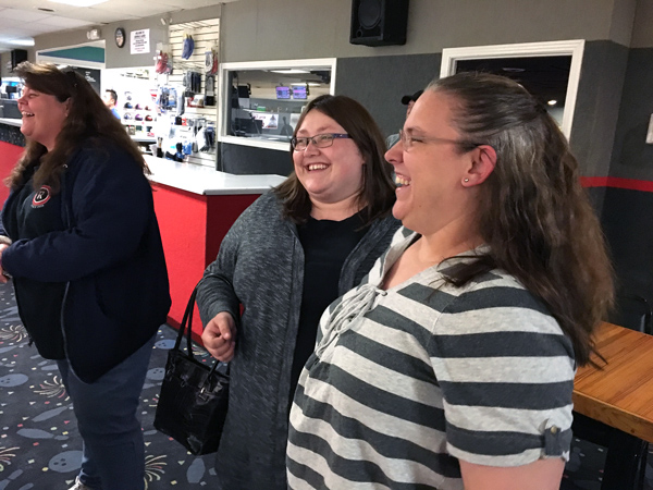 Beth shares a laugh with Developmental Disabilities Ministry care givers Janet (left) and Sheila (center).