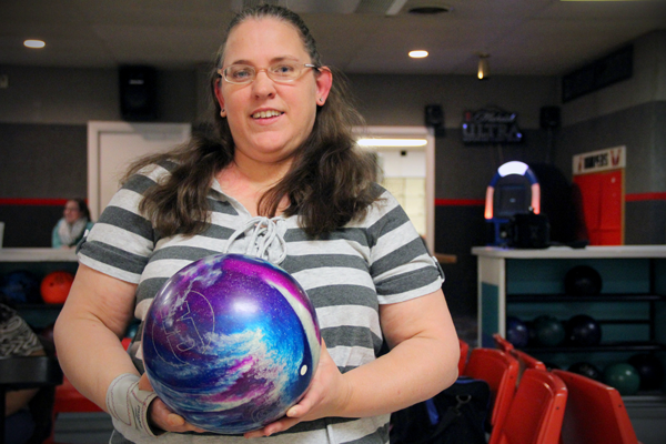 Beth displays her colorful bowling ball.
