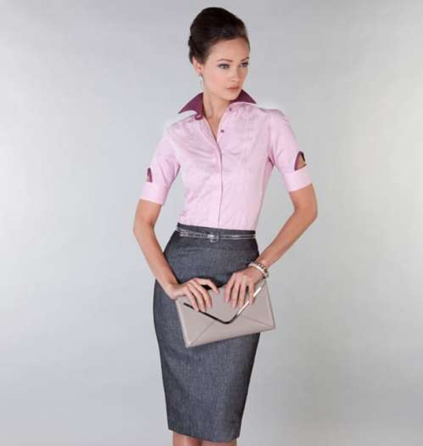 100% Egyptian Cotton easycare shirt in candy pink stripes, paired with skirt in a textured dark grey fabric with sheen.