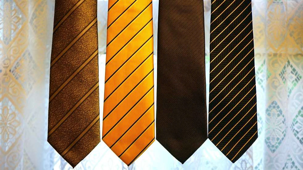 A tie with intricate designs can breathe new life into your usual suits.
