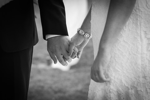 Holding hands during the ceremony, exchanging vows