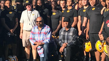 Former pro football players Harris, Mitchell drop by Greenwood practice bringing along their perform