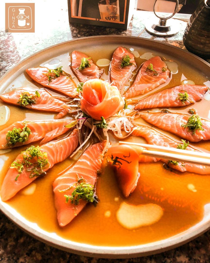 Salmon Uzuzukuri with traffle oil