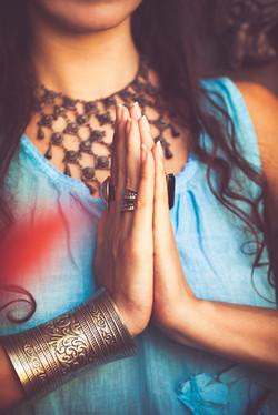 close up of woman hands in namaste gestu