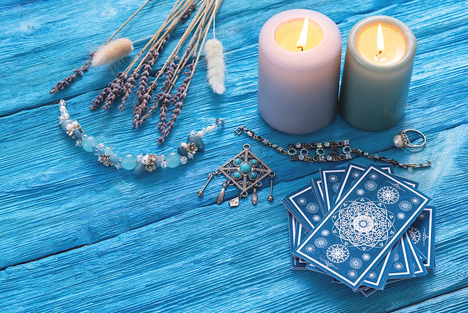 Blue tarot cards deck on blue wooden table background..jpg