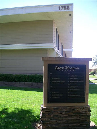 Picture of office building and the plaque showing the name of the office complex:  Green Meadows Office Park