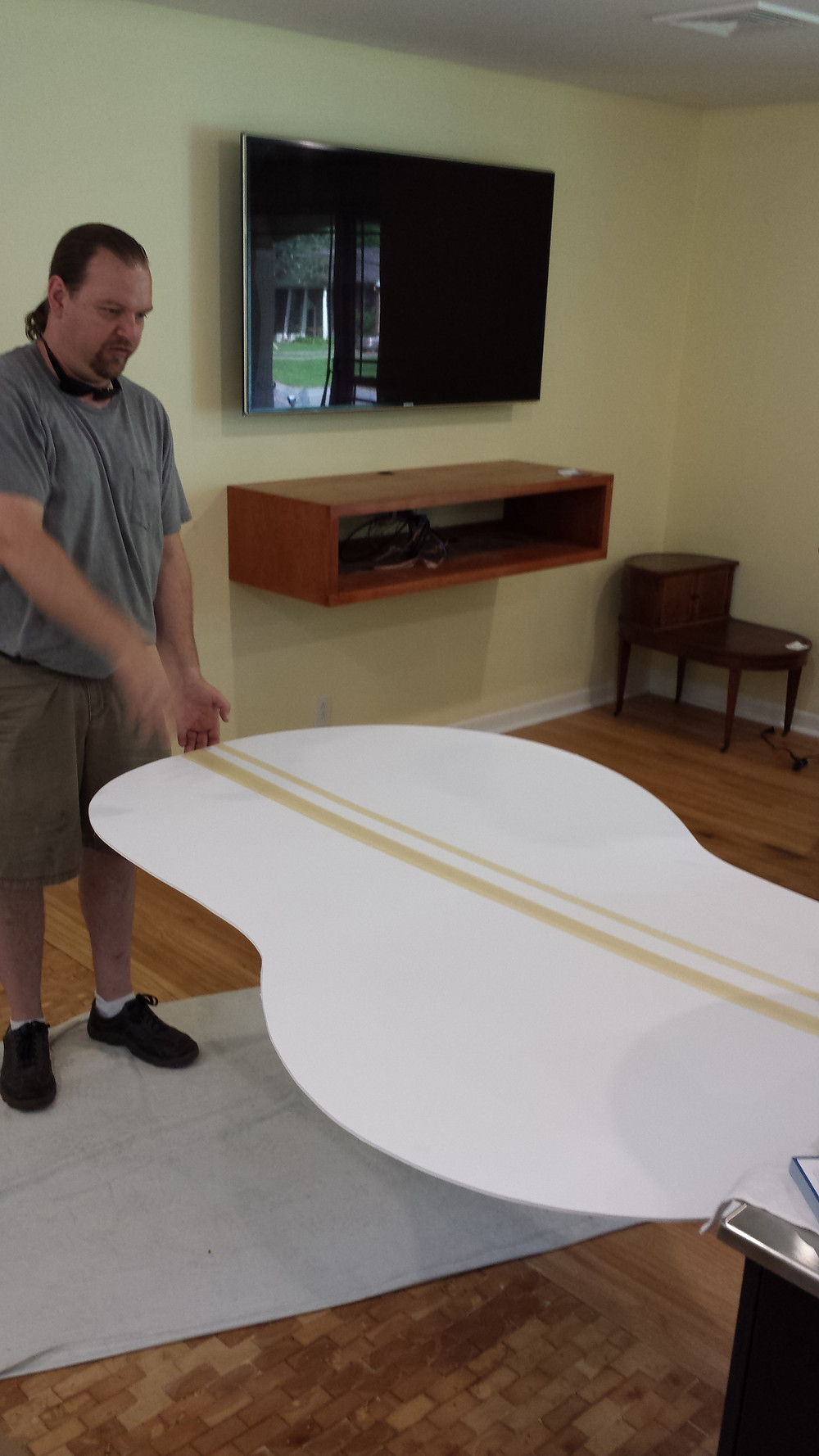 Gary Gaines checking the exact fit of the guitar shaped cantilevered  table.  This is a mock-up made of foam core/gator board. Copyright 2015 Marla Baxter Sanderson - SockOnARooster