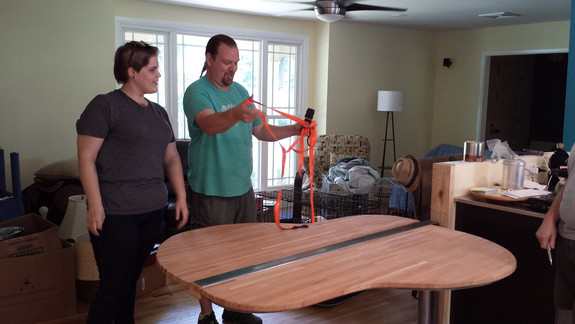 July 26, 2015 - Final installation of the the guitar shaped table into its already installed base and the bar top on the half wall. Copyright 2015 Marla Baxter Sanderson - SockOnARooster.com