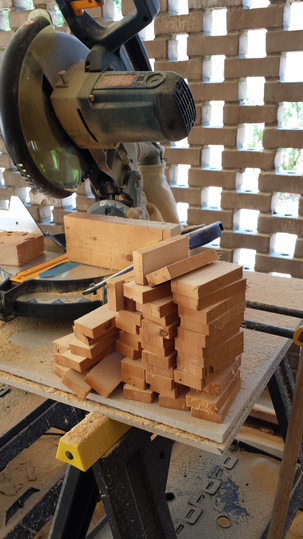 1967 studs being cut into wood tiles for end grain wood floors. Copyright 2015 Marla Baxter Sanderson - SOCKONAROOSTER.COM