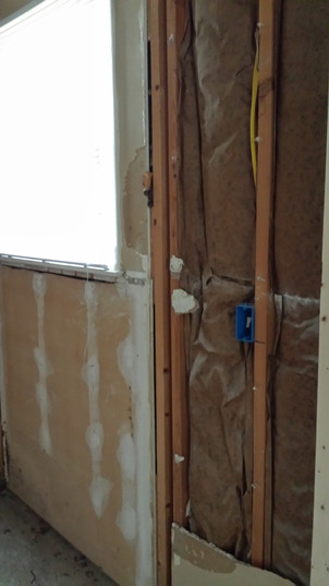 Exterior wall of Master bathroom. We kept the light switch here. Copyright 2015 Marla Baxter Sanderson - SockOnARooster.com