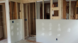 Drywall going up on the new wall. Copyright 2015 Marla Baxter Sanderson - SockOnARooster.com