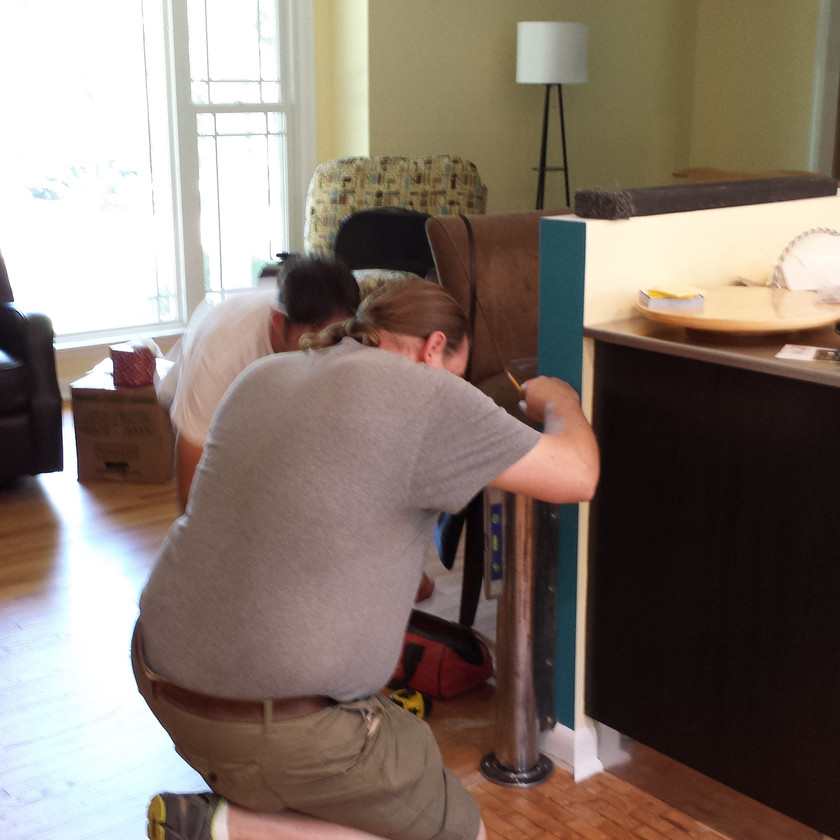 Gary placing the pivot base for the guitar shaped table. Copyright 2015 Marla Baxter Sanderson - SockOnARooster.com