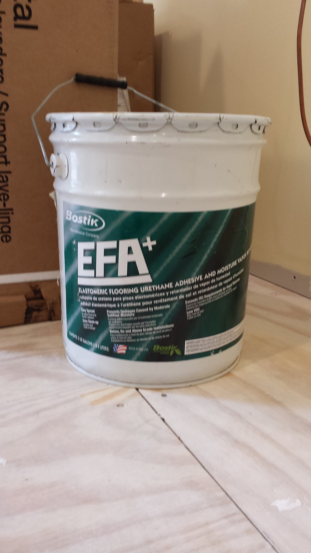 CLICK LINK FOR TECHNICAL DETAILS FOR Bostik EFA+ Elastometric Flooring Urethane Adhesive and Moisture Barrier was the glue we used to adhere the wood tiles to the sub-floor.  Copyright 2015 Marla Baxter Sanderson - SockOnARooster.com