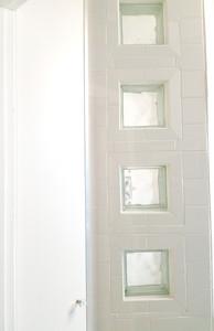 His and hers ensuite master bathrooms after construction. Copyright 2019 Marla Baxter Sanderson - SockOnARooster.com