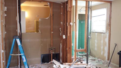His and hers en-suite master bathrooms during construction. Copyright 2015 Marla Baxter Sanderson - SockOnARooster.com