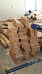 Another stack of cut wood before they become wood tiles for the end grain wood floors. Copyright 2015 Marla Baxter Sanderson - SOCKONAROOSTER.COM
