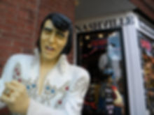 Nashville city scene of Elvis statue and shop window in back  © 2019 Marla Baxter Sanderson