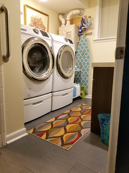 Downstairs laundry room and full guest bathroom combination after update.  Samsung washer and dryer. Copyright 2019 Marla Baxter Sanderson - SockOnARooster.com