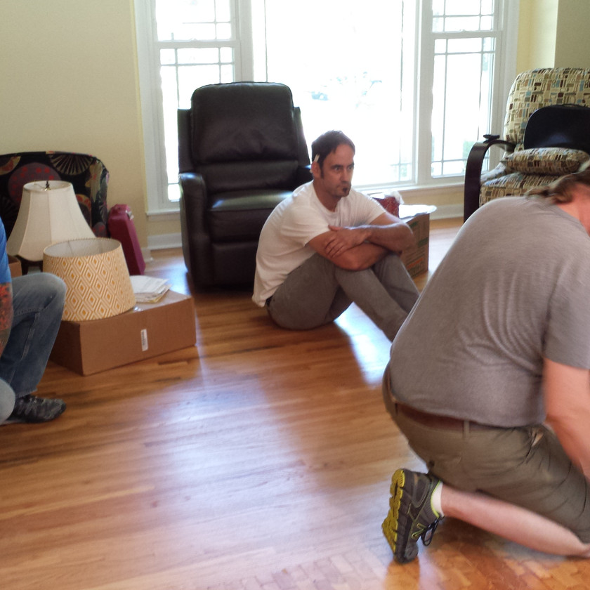 Sean observes Gary beginning the install of the pivot base for the guitar table. Copyright 2015 Marla Baxter Sanderson - SockOnARooster.com
