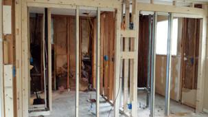 New wall with 2 pocket doors for 2 en-suite bathrooms. Copyright 2015 Marla Baxter Sanderson - SockOnARooster.com