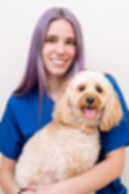 Staff headshot photo of a vet nurse with her dog at Parramatta Veterinary Hospital