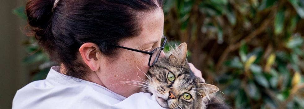 Photo-of-Woman-hugging-cat
