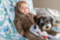 Photo of kid and his dog hanging out on the couch during our indoor pet photography session in Sydney
