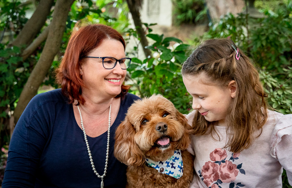 Mother-and-daughter-with-family-dog