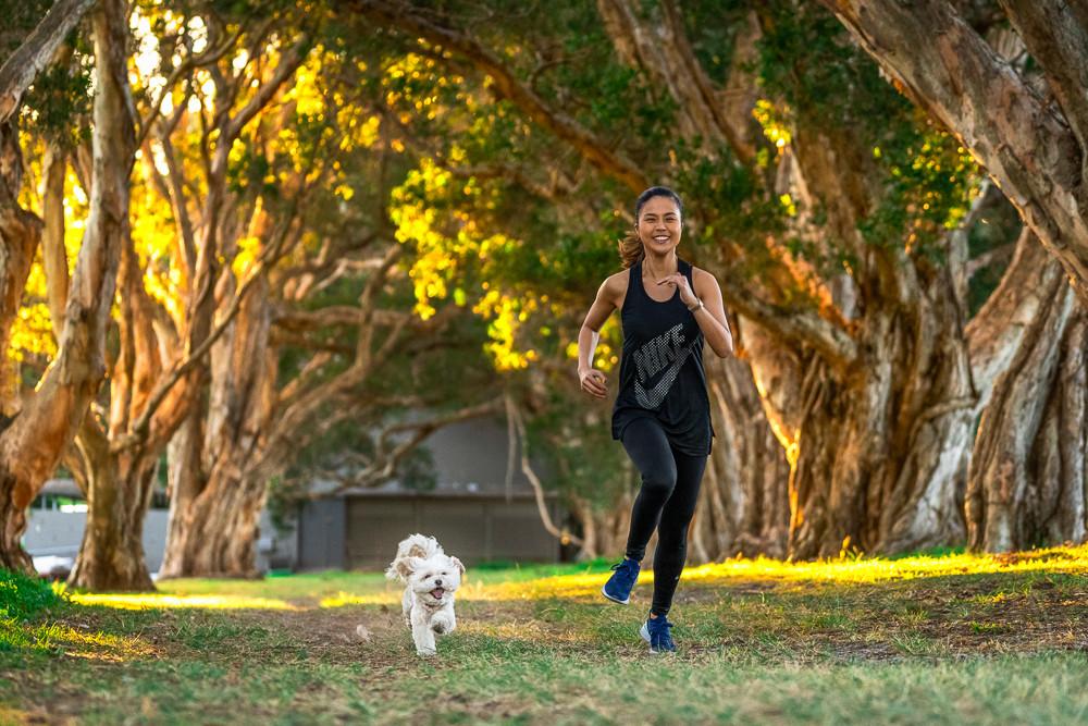 Dog-and-dog-mum-running-through-Centennial-Park.jpg