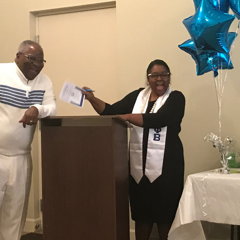 Rev. Rudolph Porter and Chapter President Jarrell Mack Litman share a friendly laugh