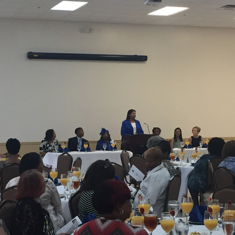 Scholarship committee chair, Soror Cassandra DeMello addressing the luncheon attendees