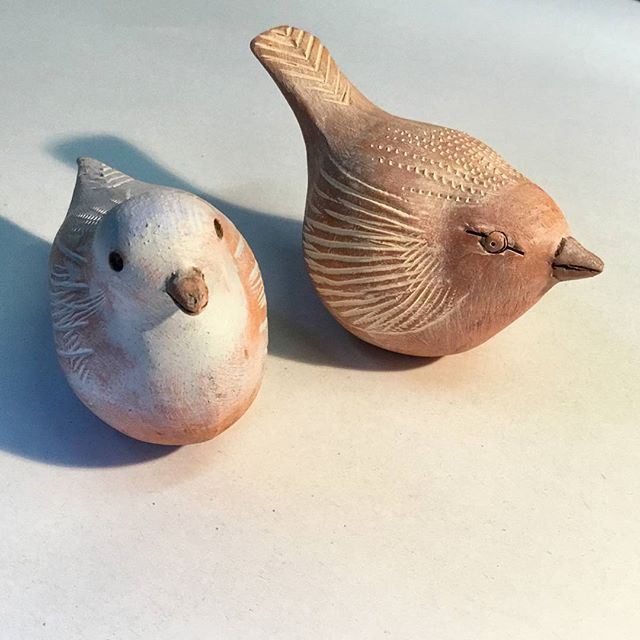Pretty terracotta birds by David Thornle
