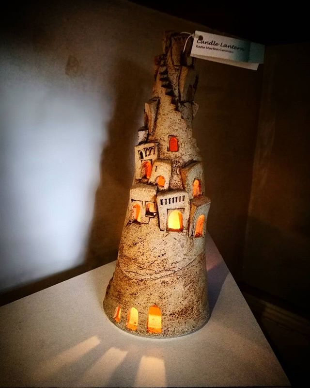 Katie Murton's candle lantern is gorgeous! A tower of ceramic houses emitting an inviting glow with