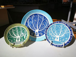 Two _kathcooperceramics little bowls, and a plate, decorated with a beautiful tree design. All in he