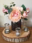 floral arrangement in grey waffle jar.jp
