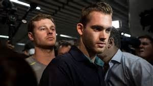 US SWIMMERS DETAINED FOR QUESTIONING