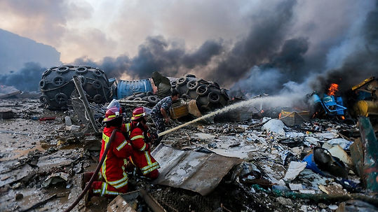 Firefighters douse a blaze burning in th