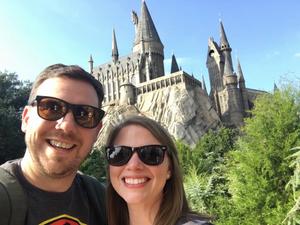 2 people taking a selfie in front of Hogwarts Castle