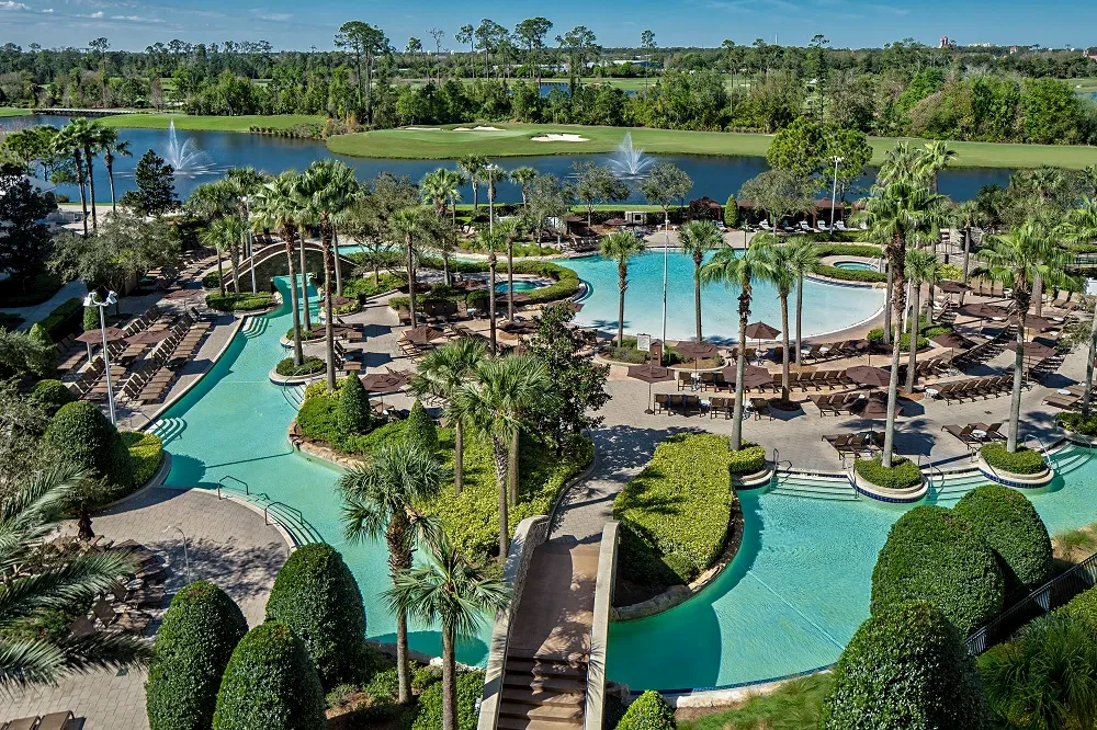 Overhead view of large pool area with lazy river and swimming areas, with ample seating