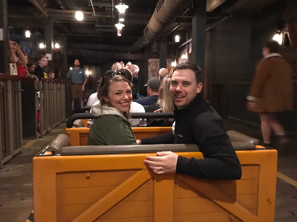 2 people looking behind them while riding Big Thunder Mountain railroad