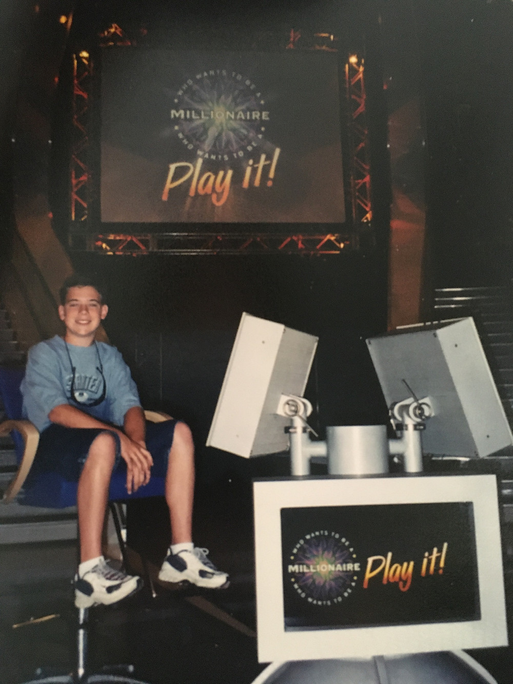 """Sitting in the contestants chair, known as the """"hot seat"""" at Who Wants to be a Millionaire - Play It! in Disney's Hollywood Studios"""