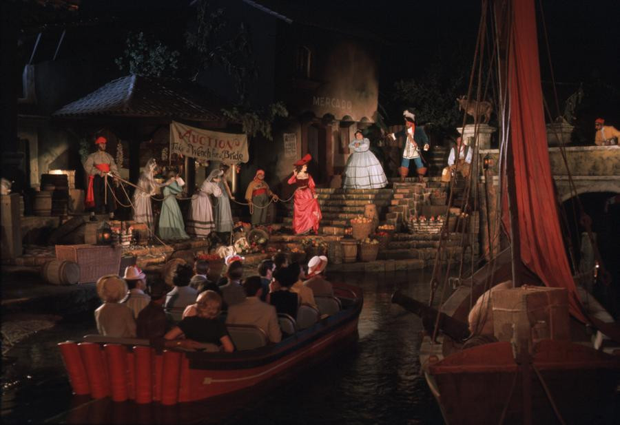 Boat floating through the ride scene with animatronic figures
