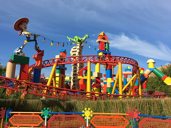 Oversized toys playing in Toy Story land around the Slinky Dog Dash roller coaster at Disney's Hollywood Studios