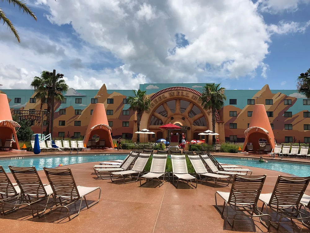 Small pool at Disney's Art of Animation Resort with traffic cone from the Pixar movie cars providing shade to lounge chairs