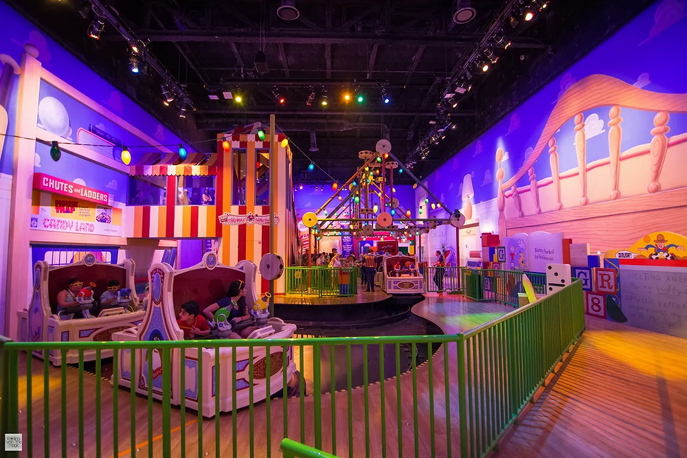 Loading area for Toy Story Mania showing Andy's bedroom and ride vehicles being loaded. Located in Toy Story Land at Hollywood Studios in Disney World