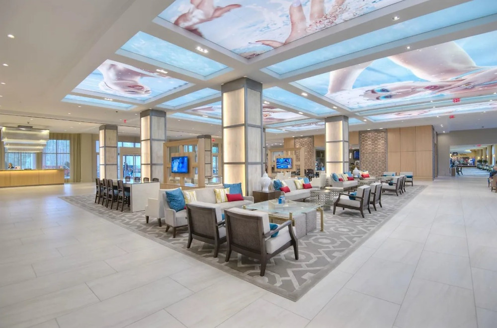 View of the expansive lobby with ample seating and check in at Hilton Bonnet Creek Resort
