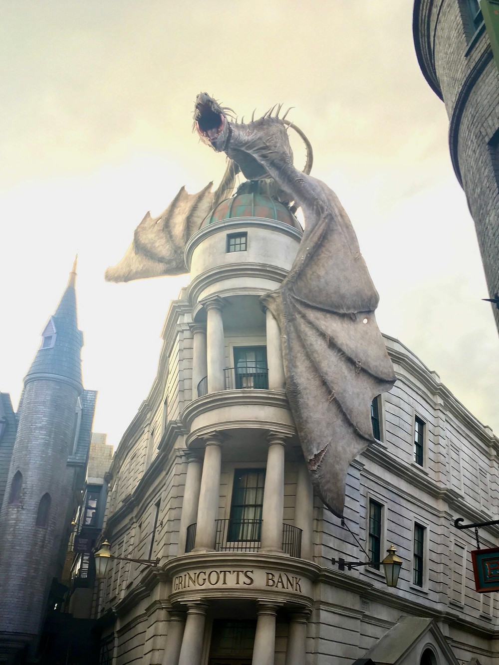 Gringotts Bank in Diagon Alley, with a fire breathing dragon sitting on the roof