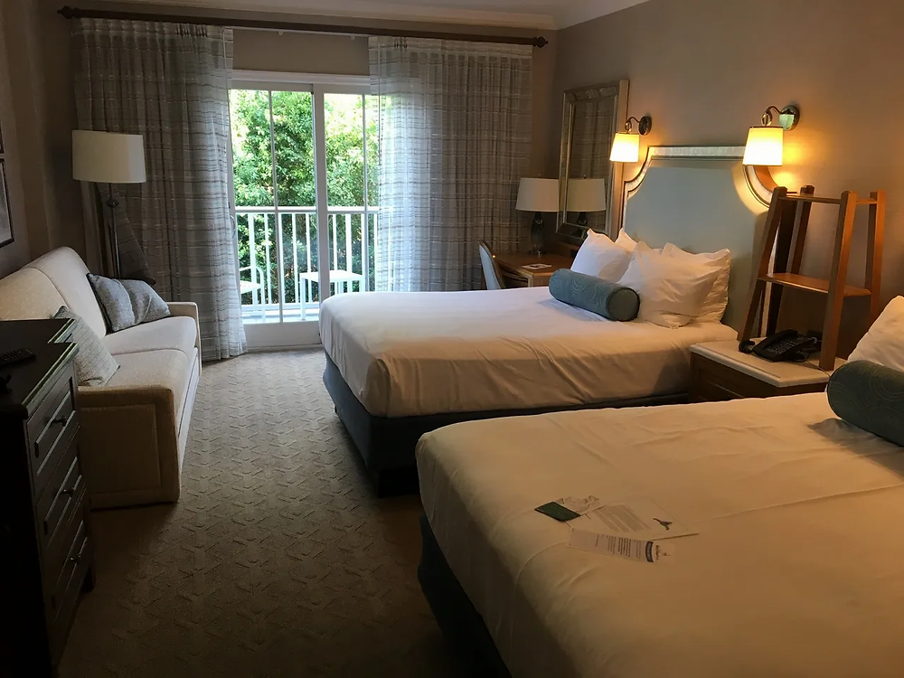 2 queen beds in a room at Disney's Beach Club Resort