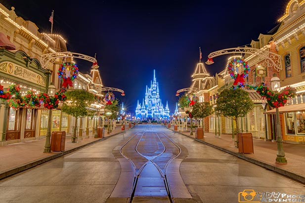 Main Street at Disney World Decorated with wreaths and lights for Christmas