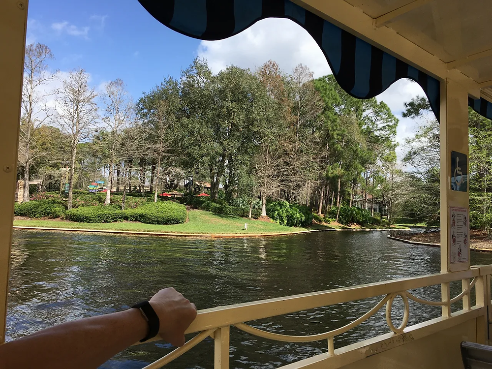 Riding in the boat that provides transportation between Disney's Port Orleans - French Quarter and Riverside resorts